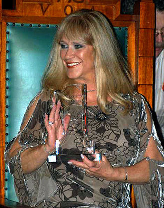 Marilyn Chambers - Chambers holding her 2005 Lifetime Achievement FOXE Award