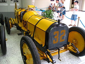 "Rear-view mirror - Ray Harroun's Marmon ""Wasp"" with its rear-view mirror mounted on struts above the car on display in the Indianapolis Motor Speedway Hall of Fame Museum."