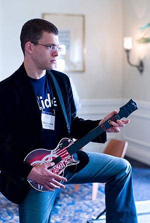 Max Levchin - Max Levchin seen playing Guitar Hero at a conference.