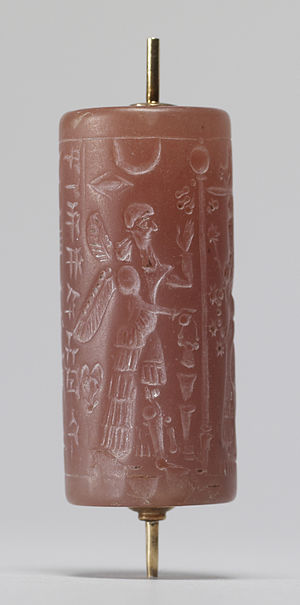 Cylinder seal - This Neo-Assyrian cylinder seal shows a ritual with winged protective deities. Walters Art Museum.
