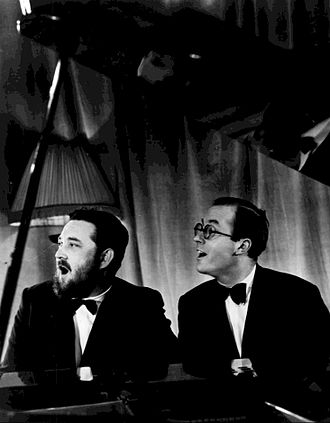 Donald Swann - Swann at right with Michael Flanders, 1966.