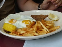 Milanesa, fried eggs and frech fries.