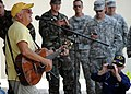 Musician Jimmy Buffet performs for members of Joint Task Force Haiti behind the U.S. Embassy in Port-au-Prince, Haiti, March 3, 2010 100303-N-HX866-005.jpg