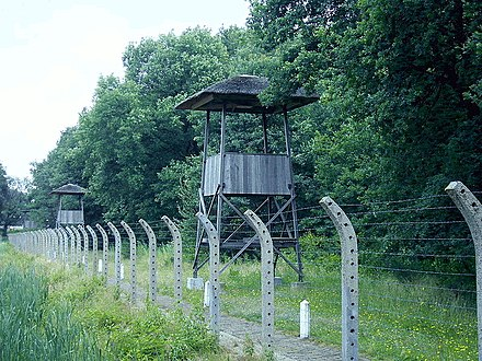 Watchtowers and barbed wire fences at Herzogenbusch concentration camp in Vught NM Kamp Vught Wachttoren.JPG
