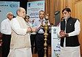 Narendra Singh Tomar lighting the lamp at the conferring of the National Awards on the Best Performing Self Help Groups under Deendayal Antayodaya Yojana - National Rural Livelihood Mission (DAY- NRLM), in New Delhi.JPG