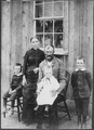No original caption. (Woman standing with her family.) - NARA - 523553.tif
