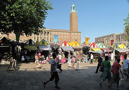Gentleman's Walk, showing the stalls of Norwich Market, City Hall and the Guildhall (right) Norwich Market from Gentlemans Walk.jpg
