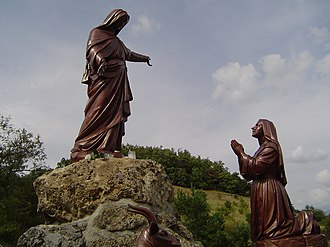 Marian apparition - Monument with a representation of an apparition of Our Lady to Benoîte Rencurel, the shepherdess visionary from Saint-Étienne-le-Laus, France.