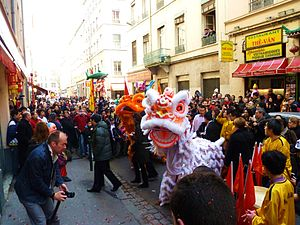 Chinatowns in Europe - Chinese new year feast, on Passet street. On the left is Gérard Collomb, Lyon city mayor.