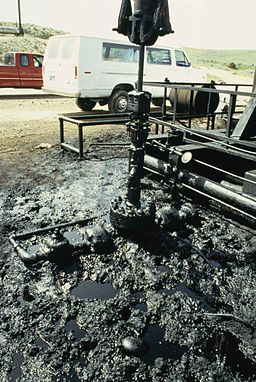 Oil well head and surrounding oil pollution on ground