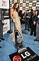 Olivia Wilde with the LG Electronics Kompressor Vacuum on 25th Spirit Awards Blue Carpet held at Nokia Theatre L.A. Live on March 5, 2010 in LA.jpg