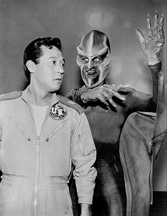 "The Outer Limits (1963 TV series) - James Shigeta and John Anderson (in Ebonite costume) in the episode ""Nightmare"" (1963)"