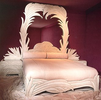 Phyllis Morris - The lacquered Palm Leaf Bed with its soaring mirrored headboard was introduced by Phyllis Morris in the early 1980s