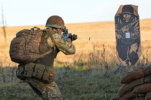 Electronic scoring system - A British paratrooper from 3rd Battalion, Parachute Regiment engaging a close range electronic knock-down target.