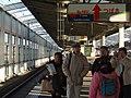 Passengers on platform of Shinkansen in Fukushima Station.jpg