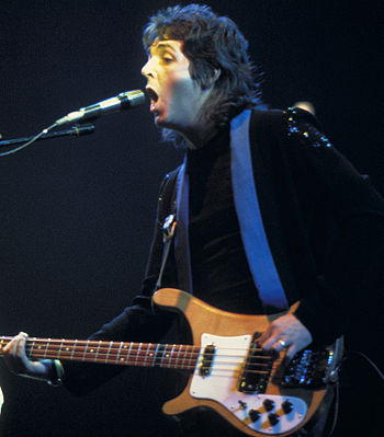 Paul McCartney during a Wings concert%2C 1976