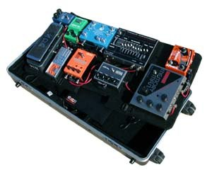 Guitar pedalboard - Fig. 2: A metal pedalboard with wheels using a single rechargeable effects pedal battery