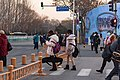 Pedestrian waiting for clearance outside Summer Palace New Gate at Kunminghu East Rd (20201222164904).jpg