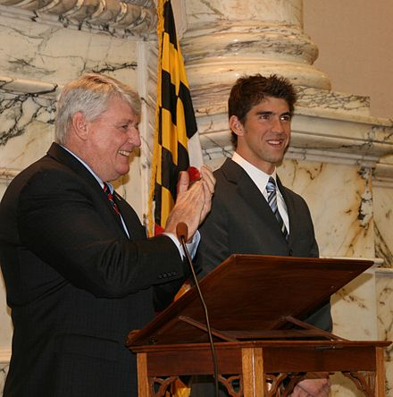 Phelps and Maryland House Speaker Mike Busch in April 2009. Both houses of the Maryland General Assembly honored Phelps that day. Phelps and Busch 2009.jpg
