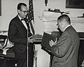 Photograph of Dr. James B. Rhoads Presenting Book of Tributes to Dr. Grover at His Retirement Party, 1965 (3874685450).jpg