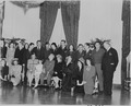 Photograph of Hollywood celebrities posing with the Truman family in the East Room of the White House, (front row... - NARA - 199258.tif