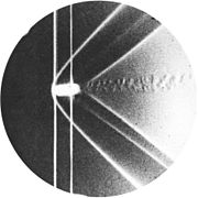Photography of bow shock waves around a brass bullet, 1888