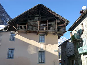 "Riva Valdobbia - Example of mixed architecture: ""Italian"" stone house with typical Walser ""Lobbia"" balconies on top."