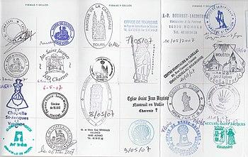 St. James pilgrim passport stamps in France on...