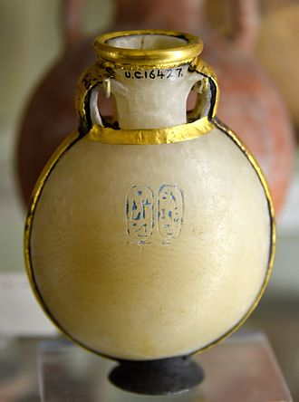 Nefertari - Pilgrim bottle. Alabaster, gold-mounted with a silver foot. Inscribed with cartouches of Ramesses II and Nefertari. 19th Dynasty. From Thebes, Egypt. The Petrie Museum of Egyptian Archaeology, London
