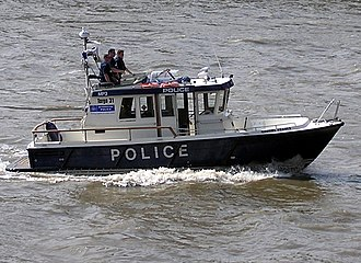 Water police - A Metropolitan Police launch on the River Thames in London