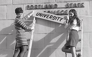 Portland State University - Students changing the institution sign after being granted university status by the Oregon State Board of Higher Education, 1969