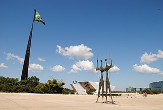 Praça dos Três Poderes - Partial view of the Three Powers Plaza with the Flag of Brazil and Os Candangos sculpture.