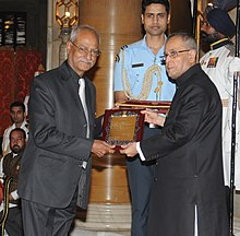 Pranab Mukherjee presenting the Sangeet Natak Akademi Fellowship to Shri Mahesh Elkunchwar, at the investiture ceremony of the Sangeet Natak Akademi Fellowships and Sangeet Natak Akademi Awards-2013, at Rashtrapati Bhavan.jpg