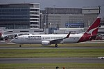 Qantas (VH-VXK) Boeing 737-838 taking off at Sydney Airport.jpg