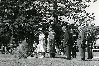 Monarchy of New Zealand - The Queen, accompanied by Prince Philip, is greeted with a pōwhiri before addressing a crowd. Waitangi, December 1953.