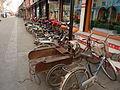 Qufu - electric bikes parked - P1060309.JPG