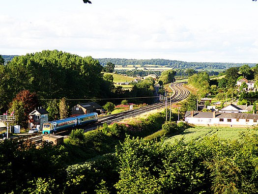 Arriva Trains Wales service passing the currently closed Pontrilas station on the Welsh Marches Line. Railway at Pontrilas - geograph.org.uk - 889611.jpg