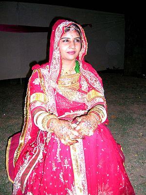 Rajput bride wearing a pink lehenga.