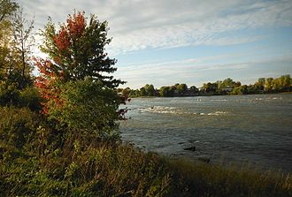 Rapides du Cheval Blanc - Rapids in fall. Green and red buoys can be seen in the rapids.