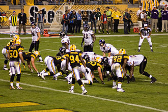 Joe Flacco - Flacco (crouching) lines up against the Pittsburgh Steelers in 2008