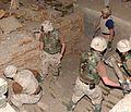 Removing al Qaeda munitions at Tarnak Farms.jpg