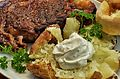 Ribeye and baked potato (13273850843).jpg