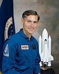 Richard M. Mullane in blue flight suit.jpg