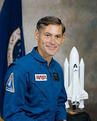 Mike Mullane - Image: Richard M. Mullane in blue flight suit