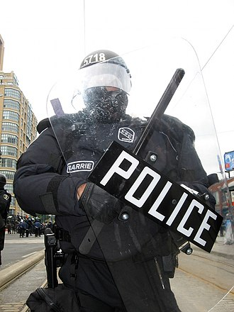 Militarization of police - A Barrie Police officer in full riot gear at the 2010 G20 Toronto summit protests