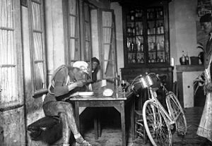 1922 Tour de France - Robert Jacquinot taking a break to eat at a cafe in Hostens during stage 5, Les Sables d'Olonne – Bayonne, 3 July 1922