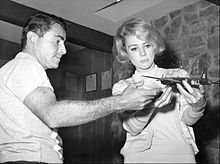 Rod serling modeling an airplane with actress inger stevens 1960