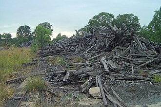 Ropes Creek railway line - The line's wooden sleepers have been torn out and dumped in a pile.