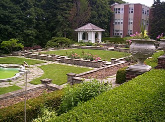 Glendon College - Rose Garden, with Wood Residence visible in the background.