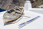 Rowing boat on a house roof - Fira - Santorini - Greece - 01.jpg